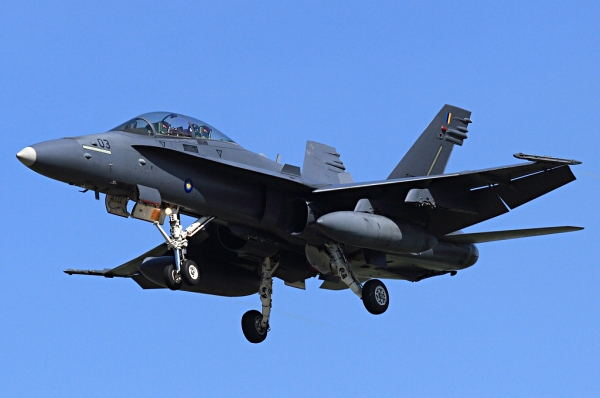 A Malasian McDonnell Douglas F/A-18 Hornet approaches after a training mission
