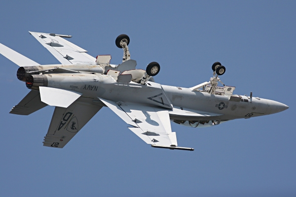 A McDonnell Douglas F/A-18 Hornet performs a barrel roll